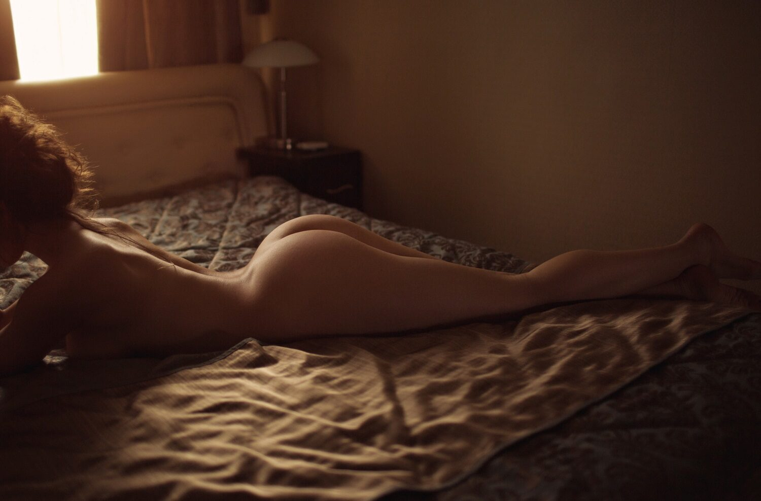 sensual woman laying on bed