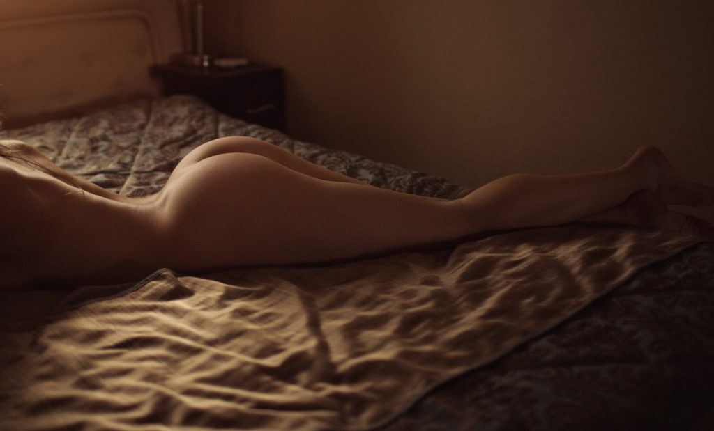 woman laying on bed naked