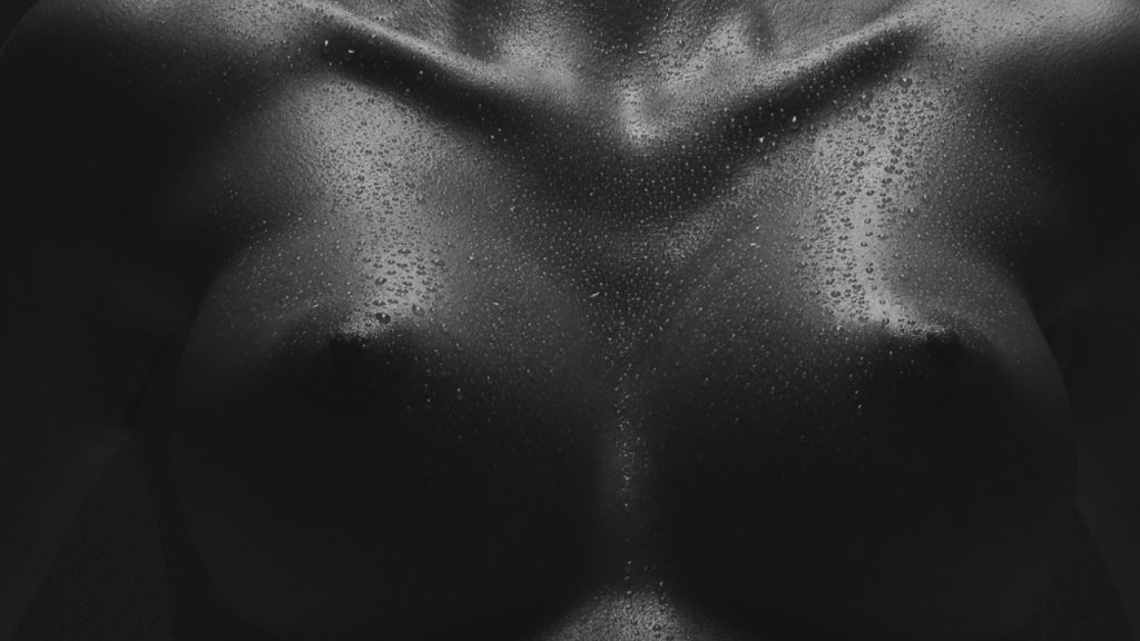 black and white image of womans breasts