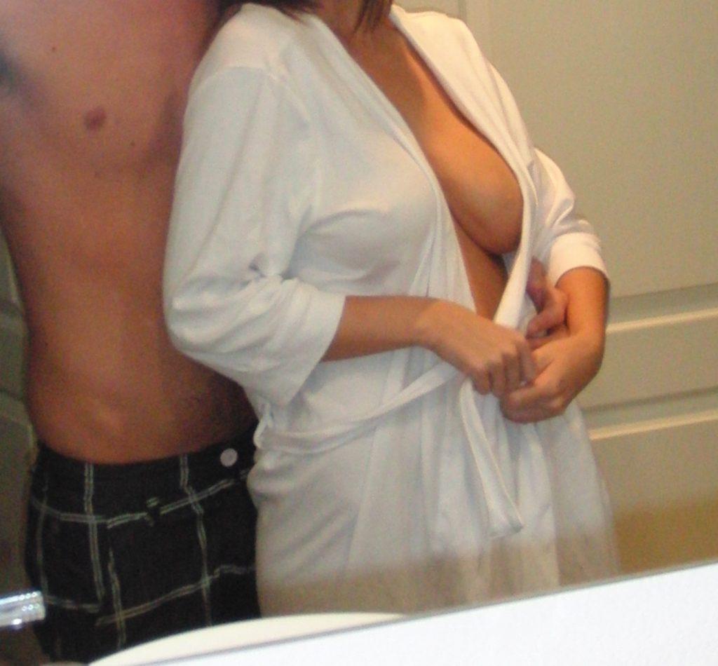 couple taking selfie in mirror