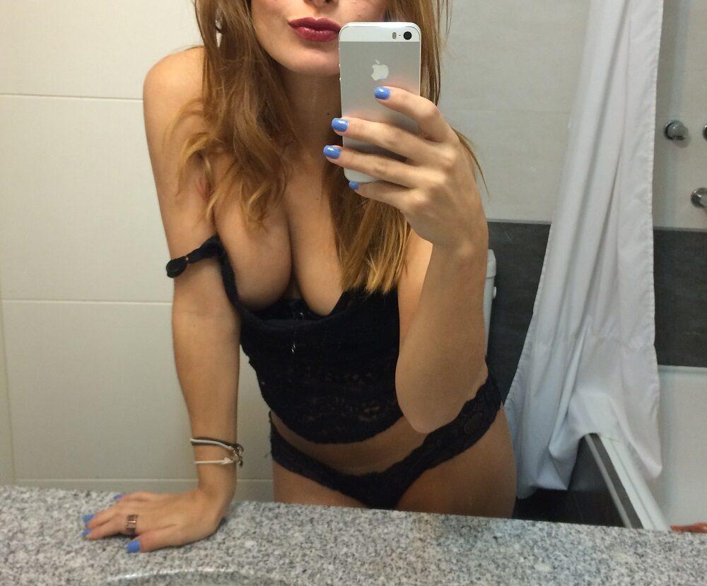 woman taking selfie in her lingerie