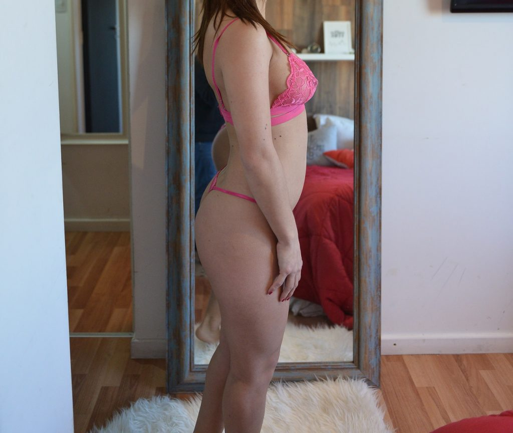 woman in lingerie posing in a mirror