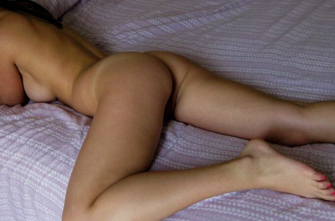 indian lady laying naked on bed